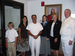 Moments before his baptism with, from left, Quentin Phillips, Marci Carter, Frank Phillips, Sister Malloy, Sister Lewis and Barry Bryant.