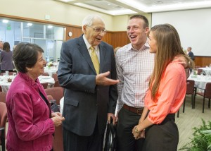 Taysom and Emily Hill visit with the late Elder L. Tom Perry at the BYU Marriott School of Management National Advisory Council breakfast on Sept. 27, 2014 (Mark A. Philbrick, BYU)