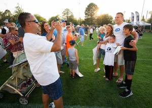 Taysom Hill enjoys spending time with fans at the annual Cougar Kickoff on Aug. 18, 2015. (Jaren Wilkey, BYU)