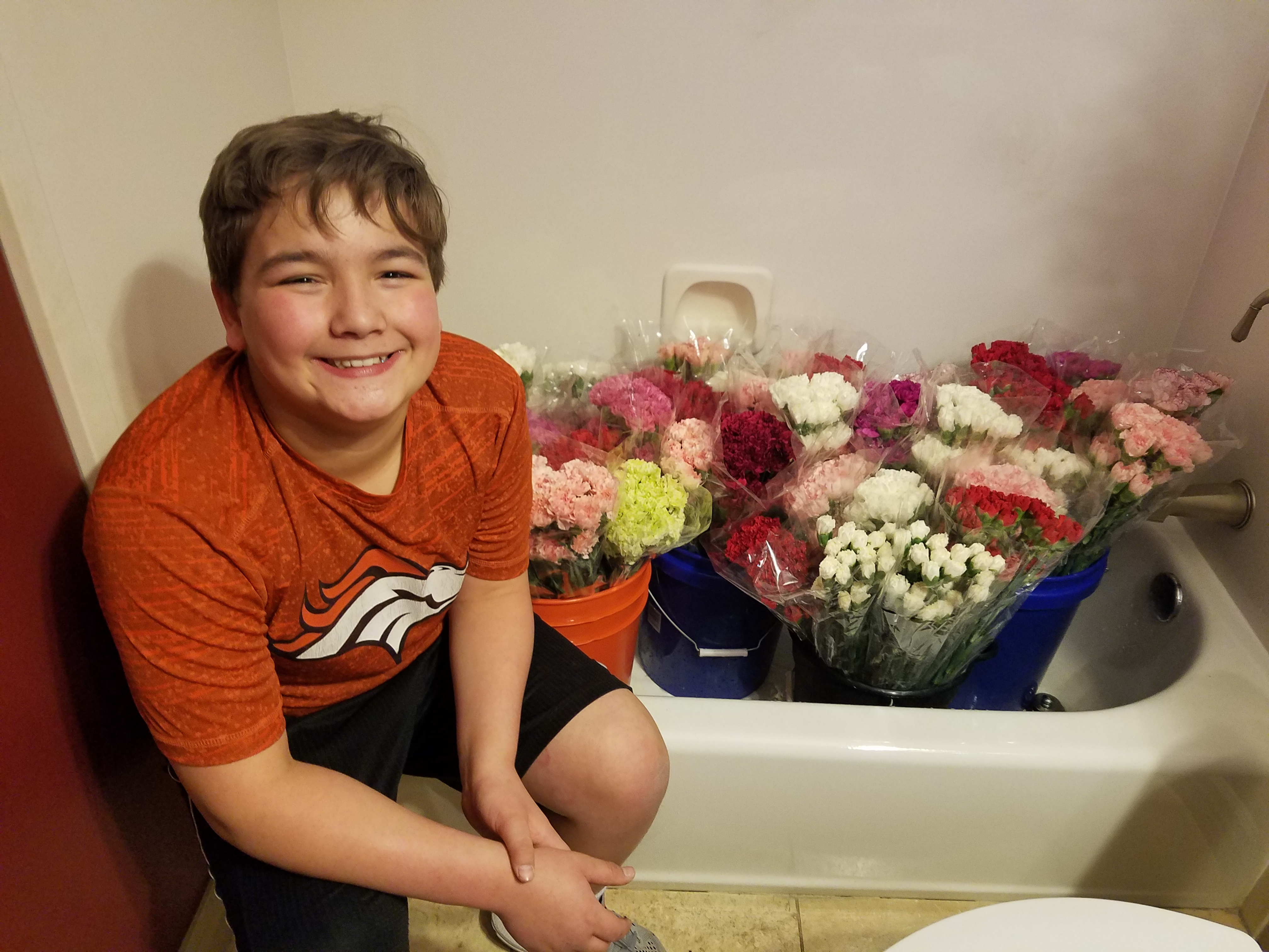 Meet the inspiring eighth-grader who bought 947 carnations for 947 young ladies